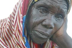 A Sudanese refugee cries
